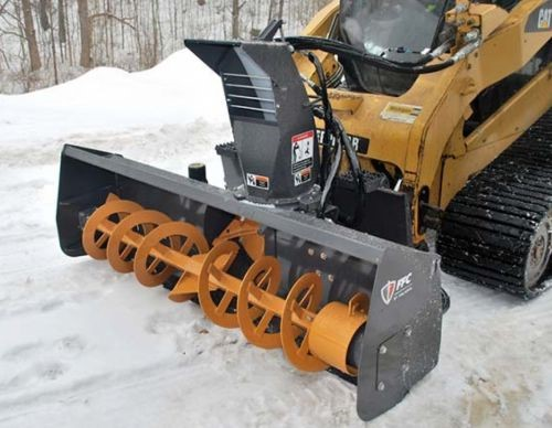 A picture containing snow, lawn mower  Description automatically generated